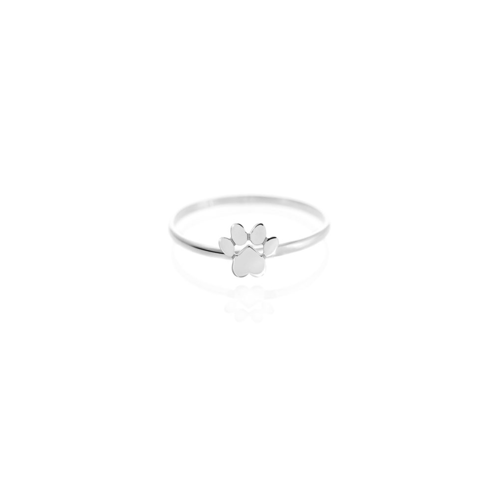 a white gold ring with a tiny paw print