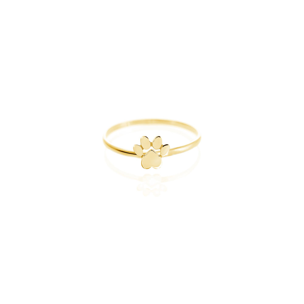 a yellow gold ring with a tiny paw print
