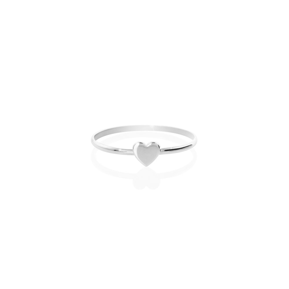 a white gold ring with a tiny heart