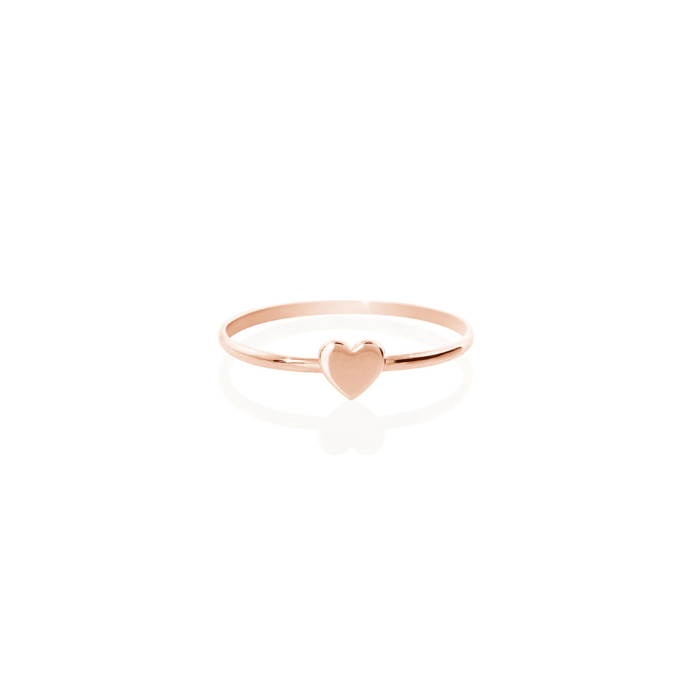 a rose gold ring with a tiny heart