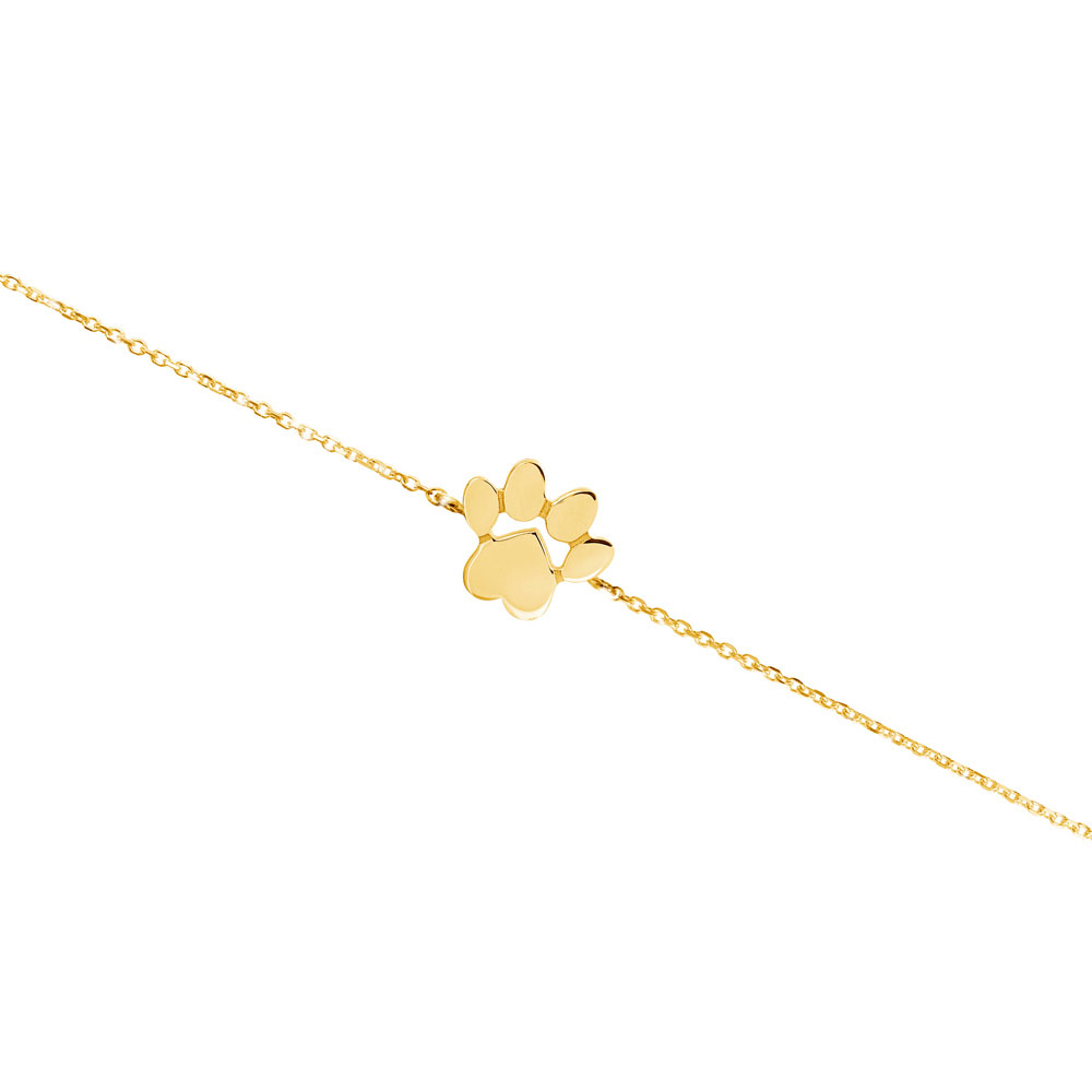 a paw print charm in yellow gold