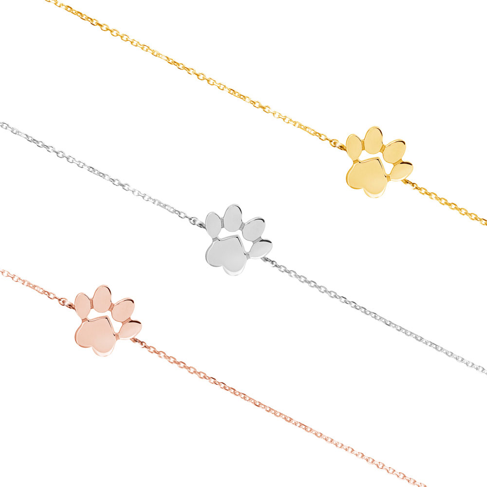 all 3 gold options of the paw print charm bracelet