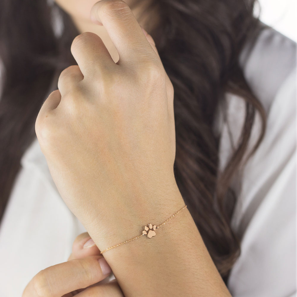 a paw print charm in rose gold