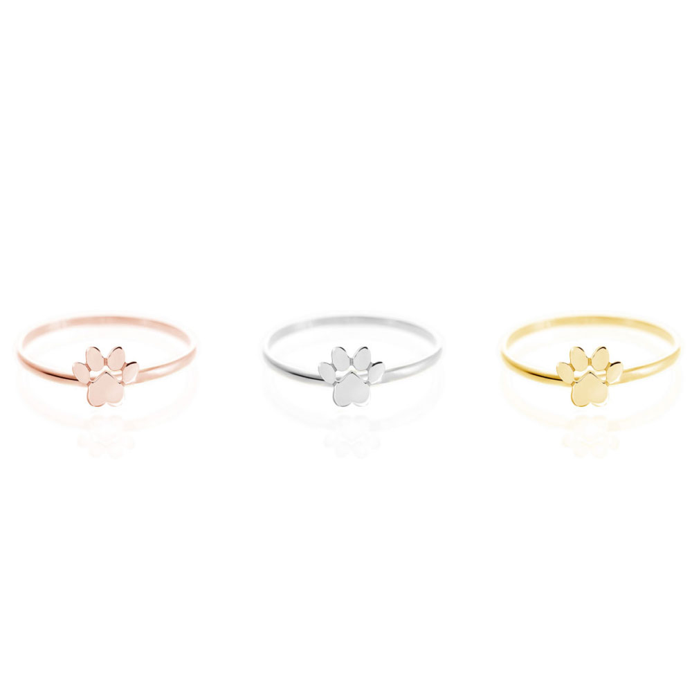 all 3 gold options of the paw print ring