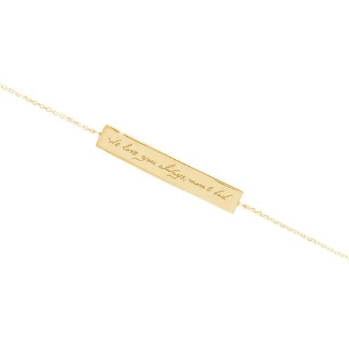 a handwritten bar bracelet in yellow gold