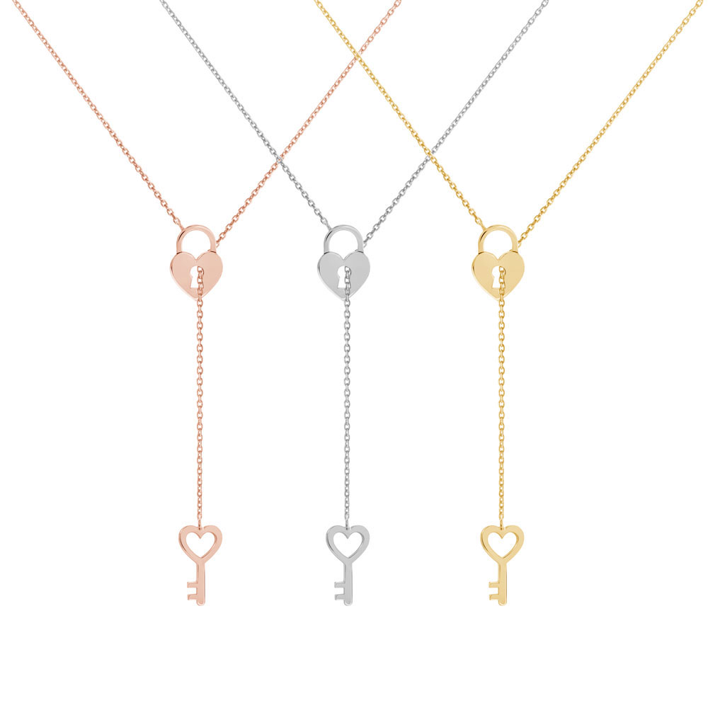 All Three Options Of The Gold Lariat Style Necklace with a Heart Locket and a Key