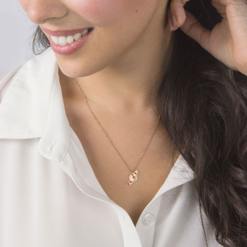 A Saturn pendant necklace in rose gold