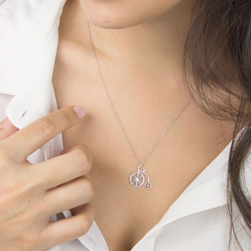 Vintage bicycle pendant in white gold
