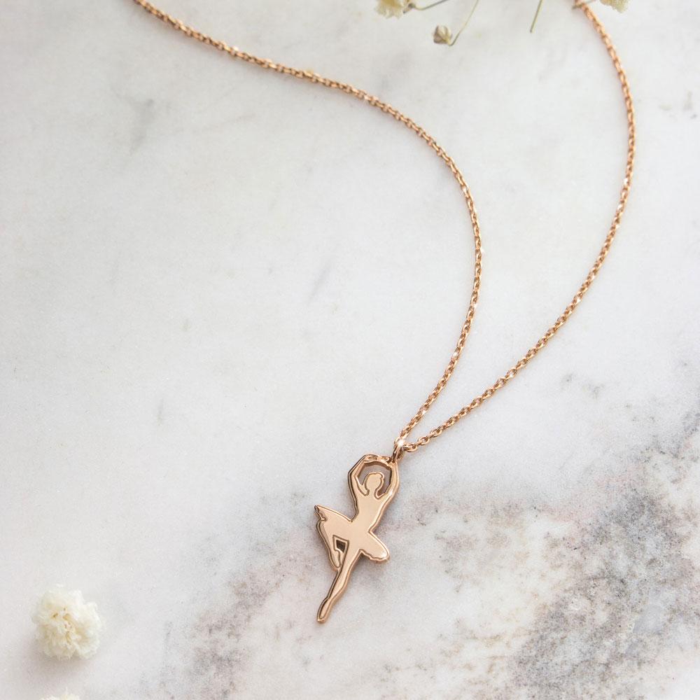a ballet dancer necklace in rose gold