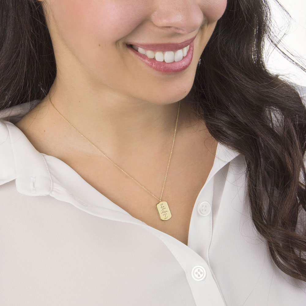 An ID Pendant with an engraved personal message in yellow gold