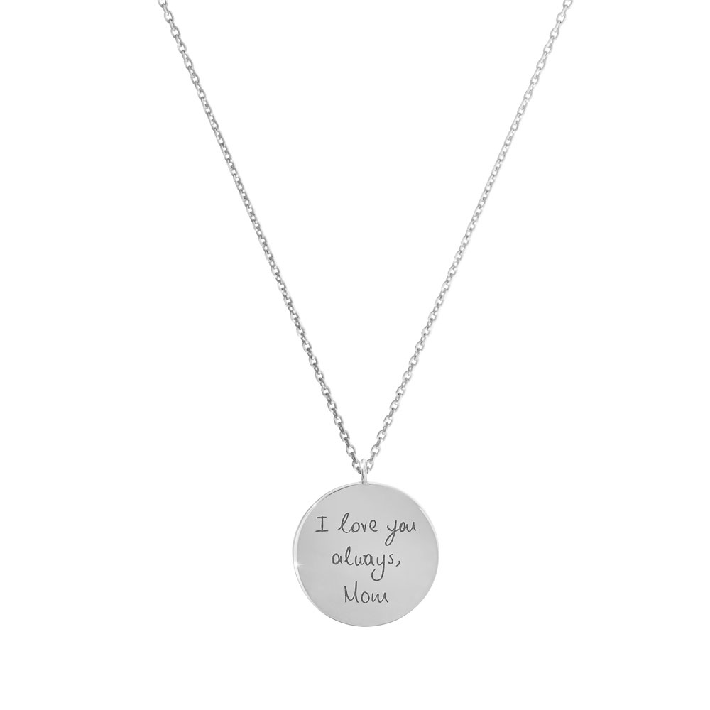A small engraved disc necklace in white gold