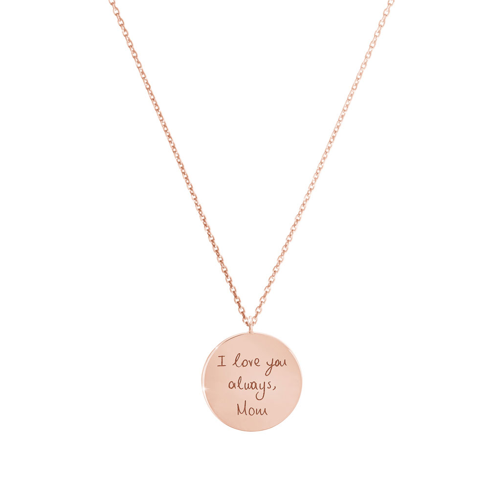A small engraved disc necklace in rose gold