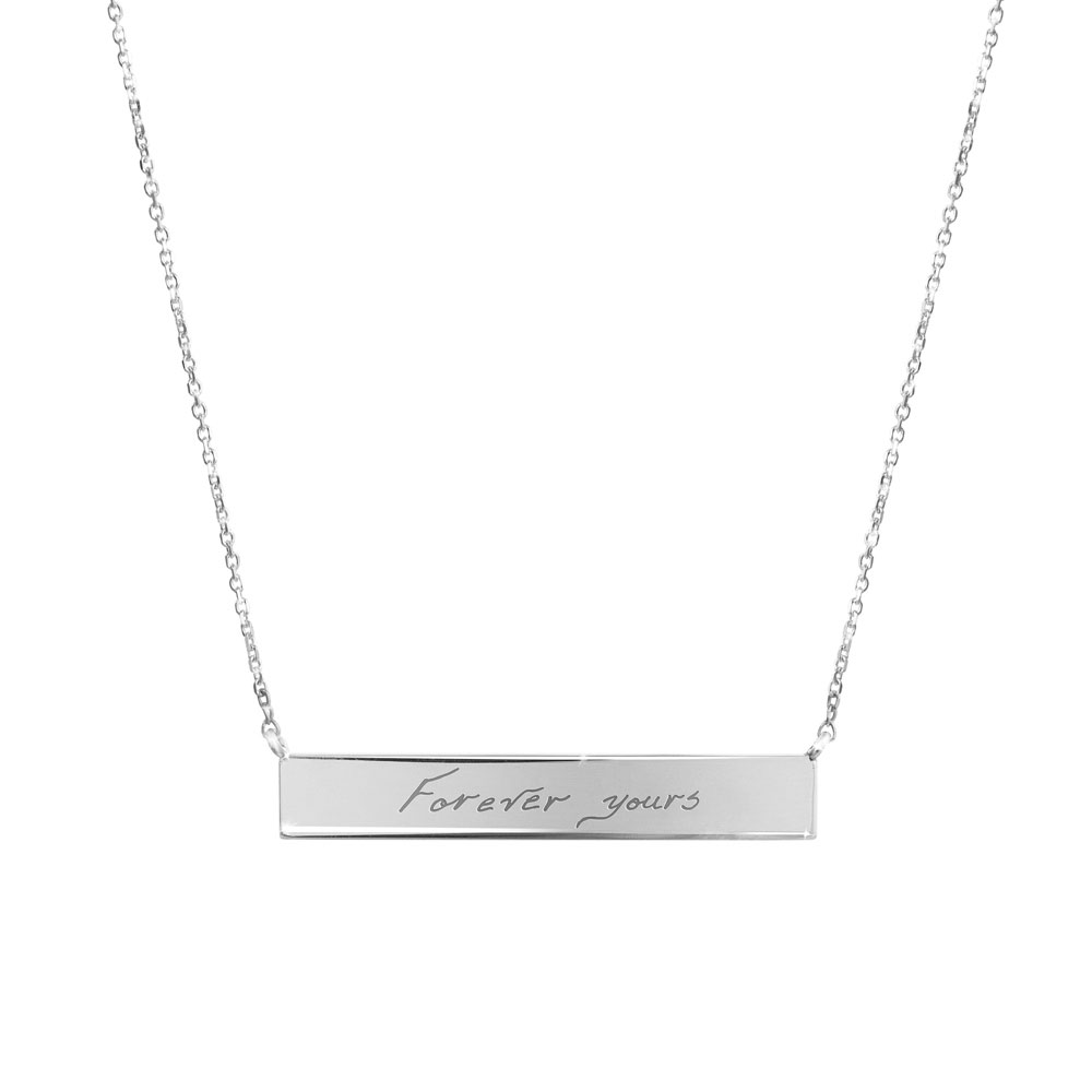 A white gold bar necklace with a personalized message