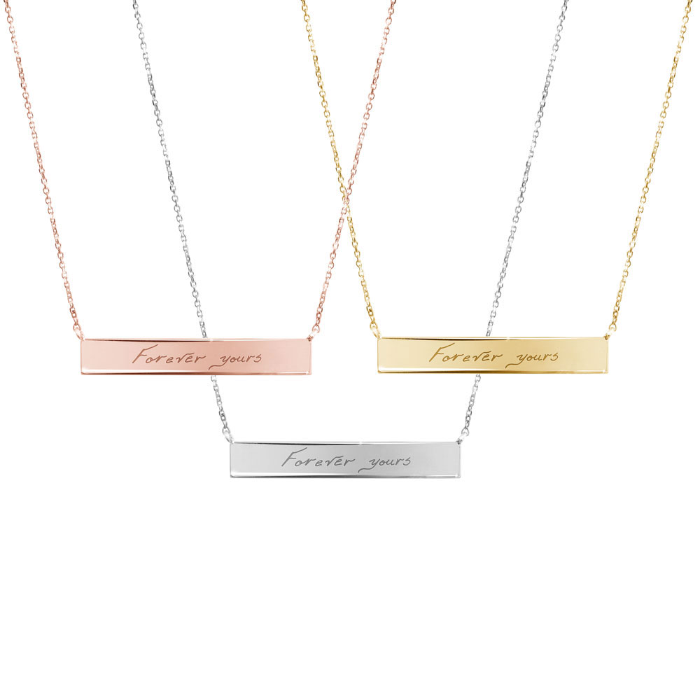A picture of the 3 colour options for the gold bar necklace