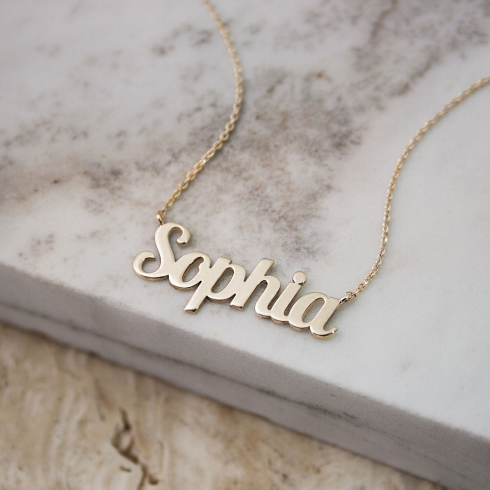 A yellow gold with a custom name on it
