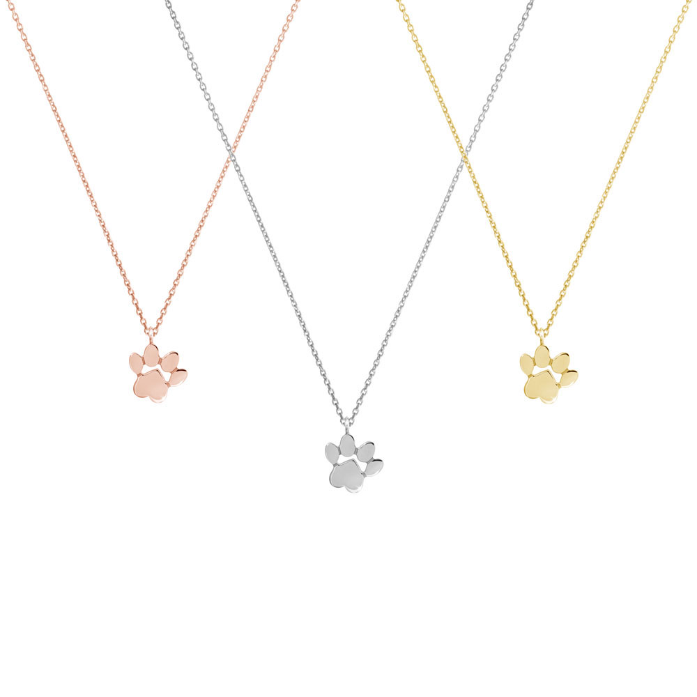 all 3 gold options of the paw pendant necklace
