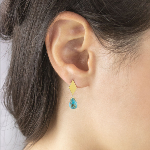 Rhombus Gold Studs with a Small Stabilized Turquoise Worn By A Woman